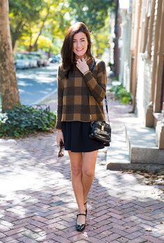 Love the combination of classic checkered sweater and mini skirt.