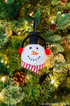 Get creative this Christmas with clear ornaments!  To DIY: 1) Fill clear ornament up with 2 different sizes of snowball confetti & close. 2) On the outside of ornament, hot glue 2 pom-poms to each side as earmuffs. 3) Add chenille stem to top of earmuffs, going from one pin to the other, & hot glue chenille stem to ornament. 4) Paint snowman's face using black & orange puffy paint. 5) Hot glue ribbon to hang ornament with. 6) Hot glue ribbon around bottom of ornament for snowman's scarf.