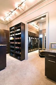 Spacious walk-in closet with carpet..Please may I have a wardrobe like this...pleease