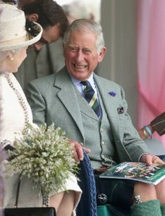 06.09.2014 - Queen Elizabeth II and Prince Charles, Prince of Wales having a fun conversations during the Braemar Highland Games 2014
