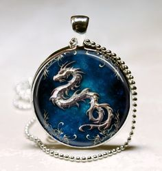 Dragon pendant charm, Dragon necklace Glass Tile pendant, Dragon Photo necklace charm (PD0077). $8.95, via Etsy.