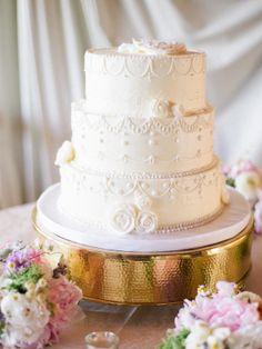 Sweet White Wedding Cake   photography by http://kateholstein.com/