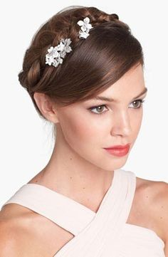 A delicate flower comb makes this milkmaid braid even more sweet.