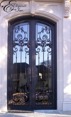 Custom wrought iron door with narrow stile and hardware notch. Wrought Iron Doors, House Doors, Stained Glass, Entrance, Hardware, Houses, House Design, Windows, Home Decor