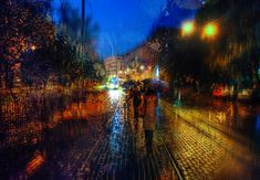 Eduard Gordeev's cityscape scenes distinctly capture the moody ambiance of dark skies and rain-soaked streets. TheSt. Petersburg-based photographeroften feature widely recognized Russian landmarks viewed through windowpanes as raindrops streak down the glass. As the rain smears colors and diffuses light, the photos nearly take on the quality of impressionist oil paintings.       Eduard Gordeev's website via [The Khool, CUDED]