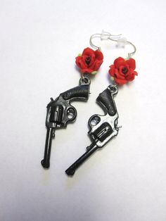 Items similar to Guns Roses Earrings Red Black Western 6 Shooter Jewelry on Etsy Skull Earrings, Rose Earrings, Beaded Earrings, Jewelry Crafts, Handmade Jewelry, Rockabilly Looks, Sugar Skull Jewelry, Western Jewelry, Country Jewelry
