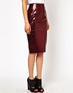 Metallic leather skirt (petite) from ASOS. $160.18. Love this for you. Adds visual interest below the waist and is both sophisticated and cool.