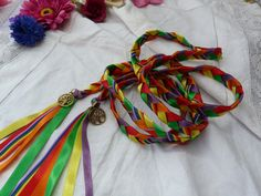 Beautiful rainbow handfasting cord, Made with 6 strands of ribbon, a rainbow one running through it and green, yellow, purple, orange and red satin ribbon, finished off with gold tone tree of life charms on each end.  All my cords are fully customisable and I can remove or change charms to your desire, happy to take custom orders, just send me a message with your ideas. This a wide flat cord, it measures 3/4 wide by 7ft long, woven with intent and blessings, comes with an organza pouch t...
