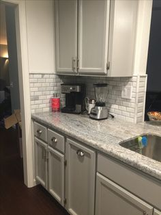 Monte Cristo Granite, Marble backsplash tiles, and grey cabinets