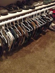 Flip Flop closet rod, installed under the bottom shelf. Those are child-sized plastic hangers.