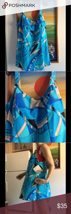 Size 18 Summer Ocean One Piece Swimsuit Dress Brand new. Excellent condition. Smoke free home. Protective liner still in place. 79%Nylon 21% Lycra Spandex. Contrast 80% nylon %20 spandex. Liner has nylon. Made in Mexico. Sold by QVC and label is Cole of California. Side ruching. Chico's Swim One Pieces