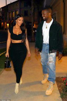 Kim Kardashian wearing Wolford Fatal Convertible Dress in Black, Yeezy Season 4 Lace-Up Boots and Hermes Kelly Mini Croc Bag