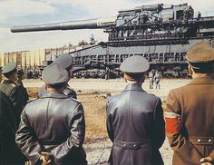 """Adolf Hitler (Center), Albert Speer (left) and other dignitaries arrived at the site at Rugenwalde (now Darłowo, Poland), where they were represented the 800 mm super heavy rail gun Dora (80-cm-Kanone (E) and the prototype of the SAU SD. Kfz. 184 ' Ferdinand '. Rugenwalde, march 19th 1943, On June, 5th, 1942 at 5.35 am Dora's first """"inaugural"""" shell was fired on Sevastopol's Northern Side. It was followed by 8 more shells, 5 of them were aimed directly at 30th battery."""