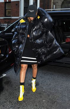 RIRI in Raf Simons Oversized Padded Coat from the Fall 2016 Collection Fenty Puma by Rihanna Yellow Heeled Booties from the Fall 2016 Collection