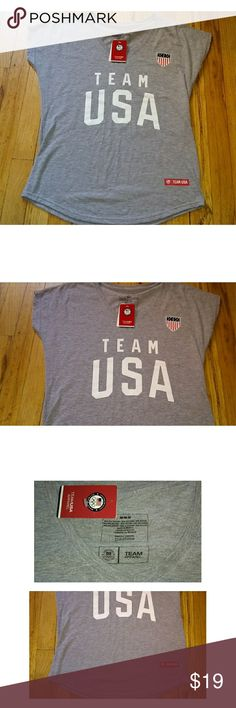 NWT TEAM USA gray cap sleeve tshirt Nwt Team USA GRAY cap sleeve shirt  Size medium in womens  22 inches armpit to armpit  26 inches in length.  Red white and blue team usa Graphics in the front plain on the back Tops Tees - Short Sleeve