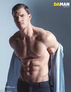 Stripping down: Alan Ritchson shows off his impressive four-pack in the December issue of Da Man Magazine