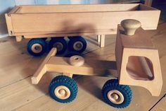 https://www.etsy.com/listing/483213227/wooden-truck-with-trailer