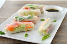 Vegan Spring Rolls Ingredients Rice Paper Wraps (10) Basil, Cilantro, or Mint – optional (2 leaves per roll) 1 Cucumber – cut into matchsticks 1 red Bell Pepper – cut into matchsticks 1 cup shredded Carrots ½ head Napa Cabbage – sliced thin into shreds Dipping Sauce ¼ cup Soy Sauce ⅛ teaspoon fresh Ginger