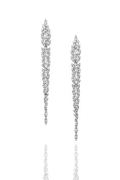 Diamonds are held under tons and tons of pressure, extremely high temperatures of fire and shuffled under shifting of tectonic plates, for a long, long time! Perfection requires sacrifice.  Discover Yasmeen earrings in 18kt white gold and white diamonds. #CASATO - http://www.casatogioielli.com/yasmeen.php