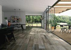 De espaço que se queria resguardar para área de convívio por excelência. A cozinha passou a ser uma verdadeira extensão da sala.