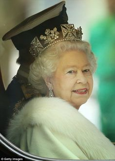 beautiful picture of the Queen in her tiara as she goes to the House of Lords