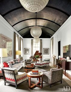 """Vintage capiz-shell globe lanterns hang from the newly vaulted ceiling. Aldrich. Interior design by Steven Gambrel."