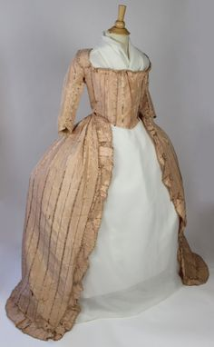 Robe à la polonaise (?), France, 1750-1799. Pale pink striped silk with self covered buttons at the collar, lace up front with boned interior, linen lining.