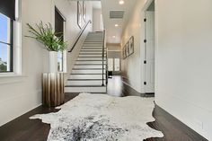 Black and White Cowhide Rug - Contemporary - Entrance/foyer - Sherwin Williams First Star - Maison de Reve Builders