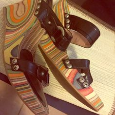 Multi Colored Vintage Style Wedge Black Italian Leather  w/silver accents                           Multi Color Wedge 4 1/2 in.                       Soft Tan Wood w/colors over that can go with almost every color (tan, yellow, orange, green, blue, red, purple)                                               like new; only worn twice. Fornarina Shoes Wedges