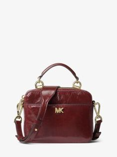 ab91d4ccec35 Constructed from crinkled calf leather with minimal hardware