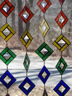 STAINED GLASS RAINBOW CHAIN SUNCATCHER  THIS LISTING IS FOR ONE 20 LONG RAINBOW CHAIN This is really a great fun piece  The piece is made up of individual 2 squares joined with a small length of chain. Each one of the squares is made up of a nice bright color with a small square bevel in the center  The total length of this piece is a full 20 Your purchase will arrive packed in a gift box with white tissue  Please note you can also ship a rainbow directly to that special someone, just let me…