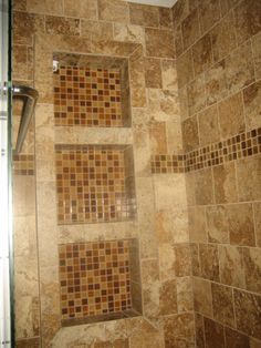 Glass tile inside shower niches.. A niche is so much better than a soap dish!  This tile isn't my style but the concept will go in at least one of the bathrooms.