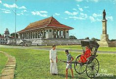 Independence Memorial Hall or Independence Commemoration Hall with a rickshaw in front in early 1970's. Jawatte Lunatic Asylum or currently the Arcade Independence Square is on the left & statue of the first Prime Minister of Ceylon Rt. Hon. D S Senanayake is seen on the right.