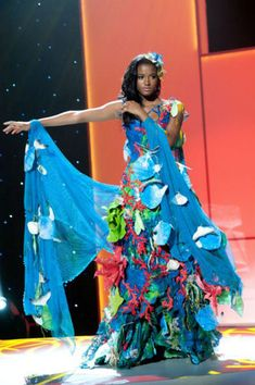 "this is "" Miss Angola"" ""30 Gorgeous Miss Universe National Costumes  STYLE BUZZ Expect Lady Gaga to be copying some of these fabulously over the top ensembles. Part of the Miss Universe pageant held September 12th, each contestant is expected to create a costume that captures the essence of her home country""  I found the American outfit quite dull compared to the others."
