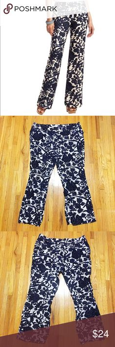"Loft ""Marisa"" linen floral print pants 14 Gorgeous linen blend fabric with navy and cream vine print. Adorned with an alluring allover vine print, we're simply obsessed with the wide leg silhouette. Pockets, double hidden hook closure. Fabulous pre-loved condition, only worn once. PLEASE NOTE: these are marked petite because I prefer pants that don't drag on the floor. These graze the top of my foot and I'm 5'5"" so it was the perfect length with sandals or wedges in the summer. Approx 36""…"
