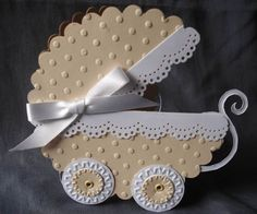 A large scalloped circle cut in half, trim from a border punch cut to fit the large circle flat ends and two different sized circles for the wheels. Add a bow! Baby Girl Cards, New Baby Cards, Origami, Congratulations Baby, Shaped Cards, Baby Shower Cards, Handmade Baby, Cool Cards, Kids Cards