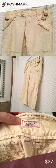 FREE PEOPLE Womens Cropped Cargo Pants 2 Capris 100% Cotton pants in cream or really light yellow. Pants are not to the floor - are cropped capris cargo style. Length approx 26 1/2. Waist lying flat 16 inches. Slight wear around waist edge. Free People Pants Capris