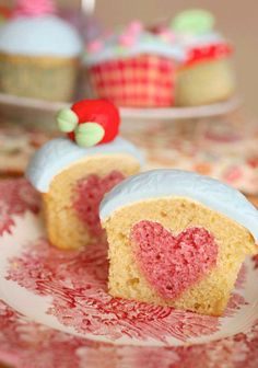 How to bake a heart into your cupcakes. so doing this for Valentines day with yellow cake and strawberry supreme hearts with chocolate buttercream- neopolatin cupcakes:)) Just Desserts, Delicious Desserts, Yummy Food, Baking Desserts, Mini Patisserie, Tolle Cupcakes, Cupcake Recipes, Dessert Recipes, Cupcake Ideas