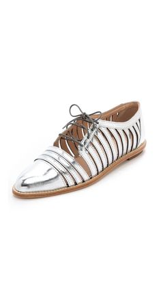 These metallic oxfords will add some serious glam to your next airport ensemble // Loeffler Randall Fay Cutout Oxfords in Silver