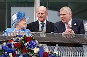 1235-Queen Elizabeth II, Prince Philip, Duke of Edinburgh and Prince Andrew, Duke of York watch the racing from the balcony of the Royal Box as they attend Derby Day during the Investec Derby Festival at Epsom Racecourse on June 4, 2016 in Epsom, England. (Photo by Max Mumby/Indigo/Getty Images)
