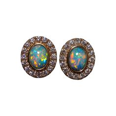 Gorgeous Opal and Diamond Stud earrings! Oval Red and Blue Coober Pedy Opals accented with 2 mm diamonds in 14k Gold.
