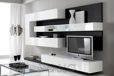 Same shape, blond wood and metal combination, with the tv more centered