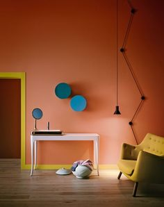 Pink wall with yellow skirting and door frame