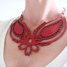 Laser-cut leather necklace. COOL.