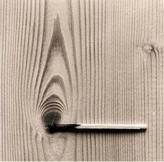 This is the creative work by Chema Madoz. I truly enjoy finding artists that cause their viewers to see things with a different perspective. It inspires me because of the contrast, unity and balance that the photo demonstrates. The vertical grain of the wood paired with the horizontal extinguished match creates a very unique photo. #creativephotography