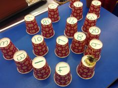 £1 for 20 Christmas cups from the Pound Shop! Put them in order... close your eyes..... take one away... whats missing? close your eyes ... swap 2 over.... whats wrong? Using just cups 1 - 5  (initially) hide the christmas bell under one.... give clue to your friends... its under an odd number, even, 1 and 3 add up to this, double 2 etc! we've had great fun....