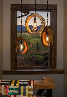 Wow, love these light fixtures made out of tree trunks.