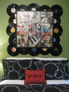 Tween Boys Rock N Roll Bedroom, This is my sons new tween rock n roll room. I found the rock n roll picture at Hobby Lobby and added the records all around it for something a little different. I painted the red around the base of the lamp to ballance out the color. I also painted the dresser to give it a cool burnt look. The bedding is from Wal-mart, but I had the pillow made to bring in more red. Still working on adding accessories to his bookcase...He is loving it…
