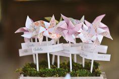 pinwheel escort cards - photo by L&V Photography http://ruffledblog.com/whimsical-italian-wedding