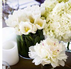 multiple vase centerpiece. multiple flower types in the same color family, the same flower in each vase.